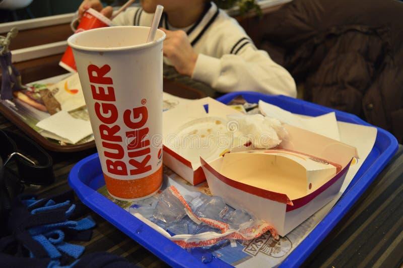 被吃的和完成的汉堡王菜单 免版税图库摄影