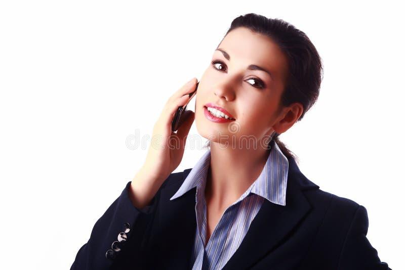 被启发的有吸引力的女实业家移动电话 库存照片