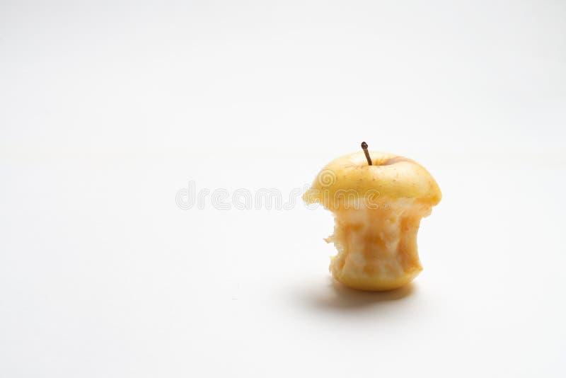 被咬住的黄色鲜美苹果 库存图片
