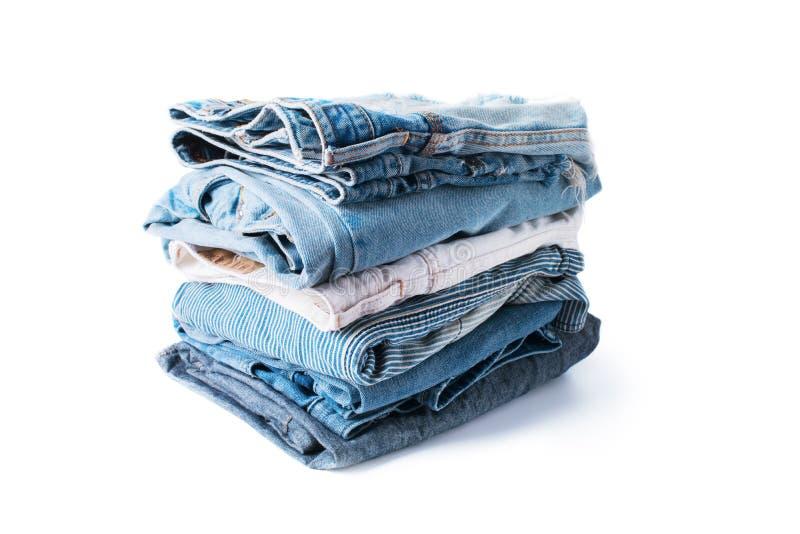被堆积的单色牛仔裤牛仔布布料亚麻布纺织品 库存图片