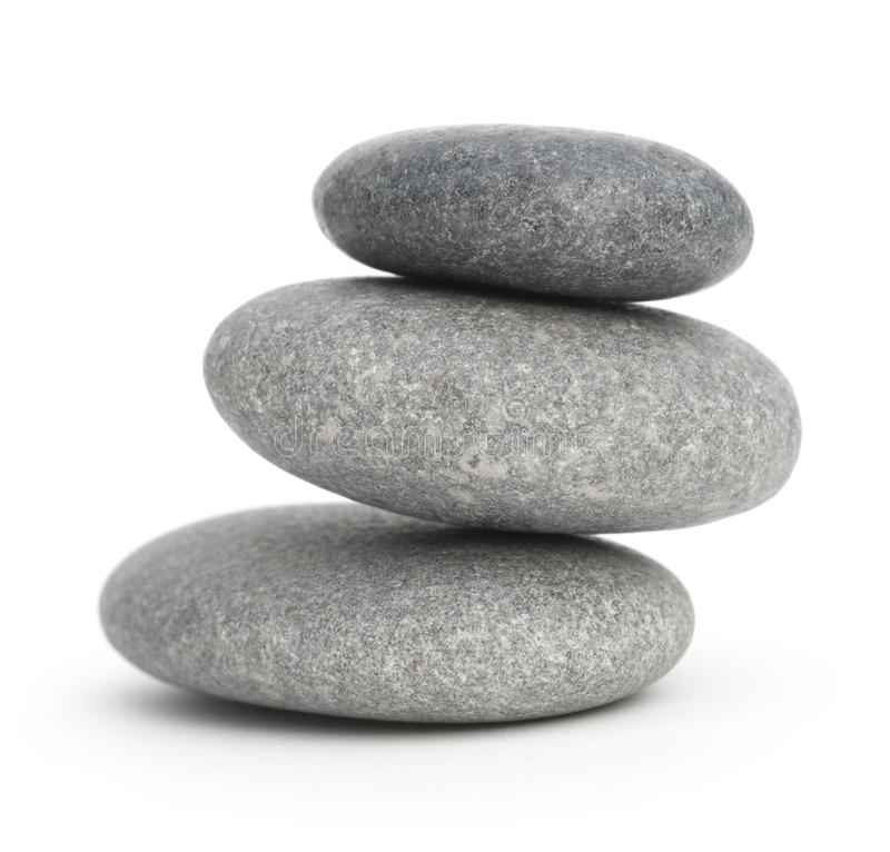 被堆积的小卵石plie向三扔石头 免版税库存照片