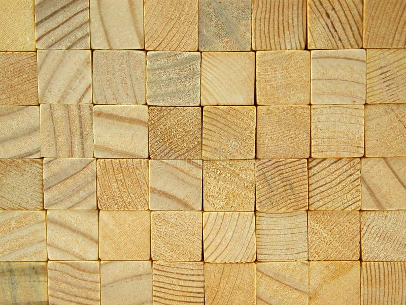 从被堆积的角形材的背景 库存图片
