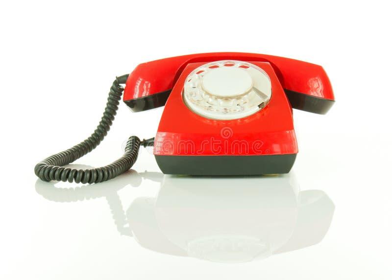 被塑造的老红色电话 库存图片