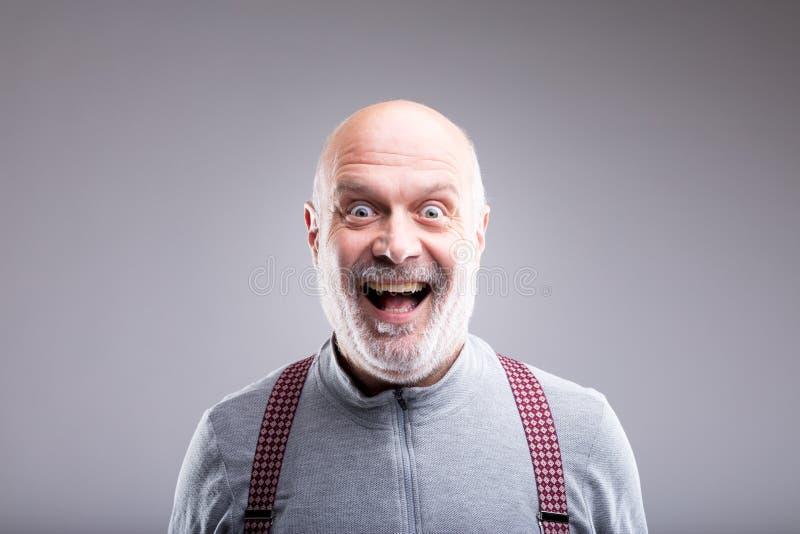 被夸大的老人微笑表示 免版税库存照片