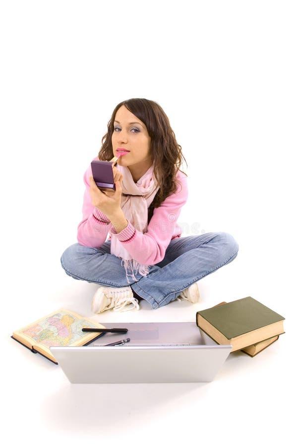 被完成她的家庭作业构成妇女年轻人的执行 库存照片