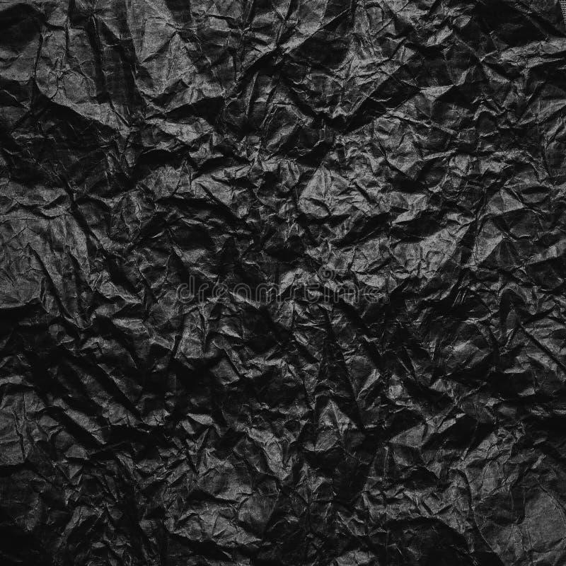 被弄皱的牛皮纸 纹理弄皱了被回收的老包装纸 免版税库存照片