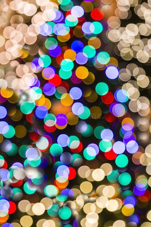 被弄脏的垂直的圣诞灯背景 库存图片