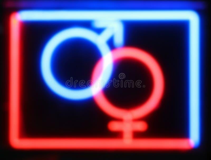 被弄脏的红色和蓝色性商店霓虹灯广告 库存照片