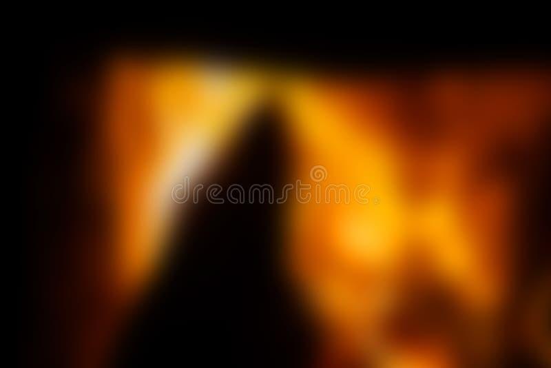 被弄脏的背景、明亮的桔子和黑色,壁炉 免版税库存照片