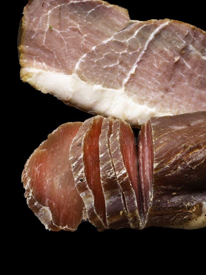 被急拉的肉和干燥被治疗的火腿从西班牙(Jamon iberico 库存图片