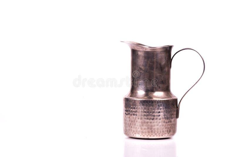 被手工造的古色古香的银色玻璃水瓶水 免版税库存图片