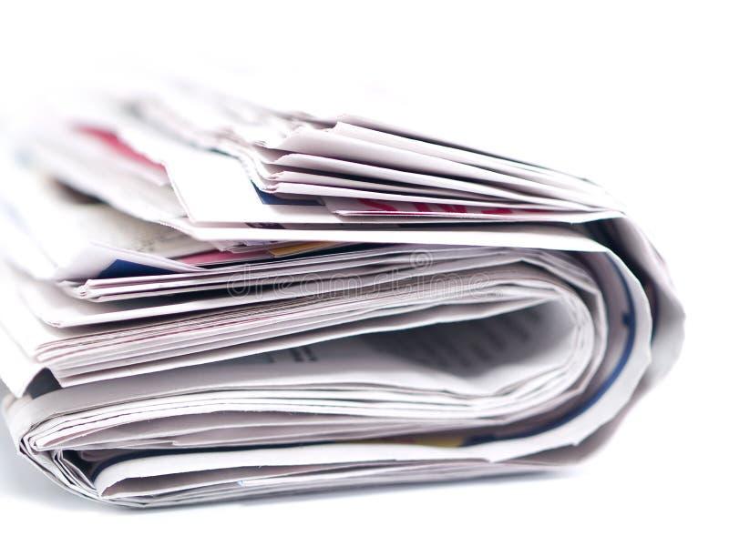 被折叠和查出的报纸 免版税库存图片