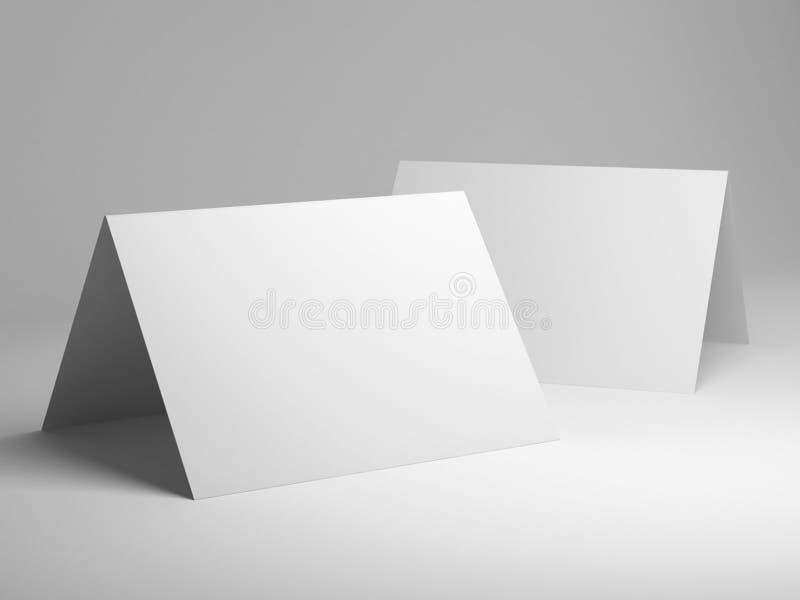 被折叠的明信片空白的模板  库存照片
