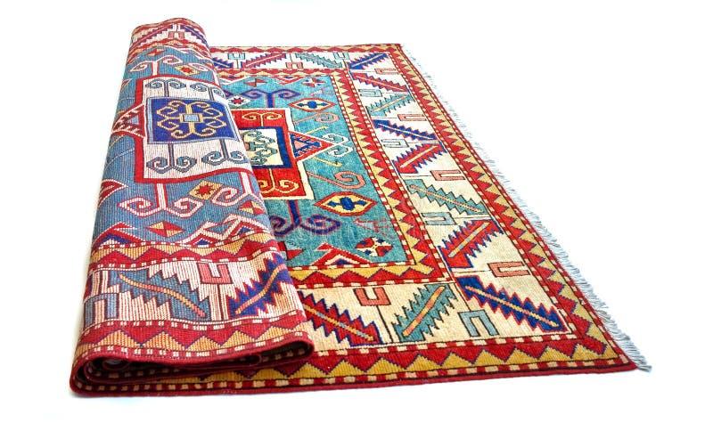 被折叠的波斯地毯 库存照片