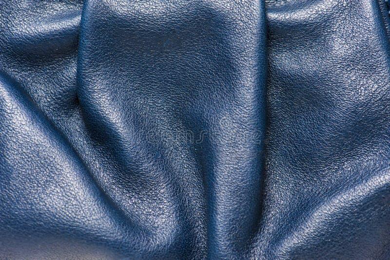 被折叠的蓝色皮革样式 库存图片