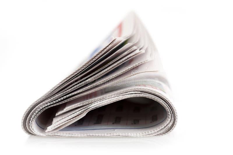 被折叠的被隔绝的报纸 库存图片