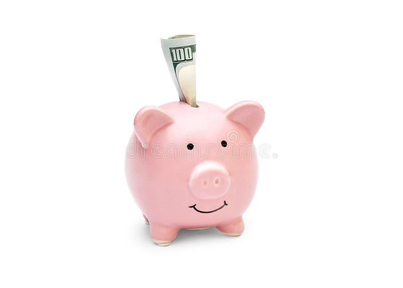 被折叠的金钱在白色背景的存钱罐中 库存图片