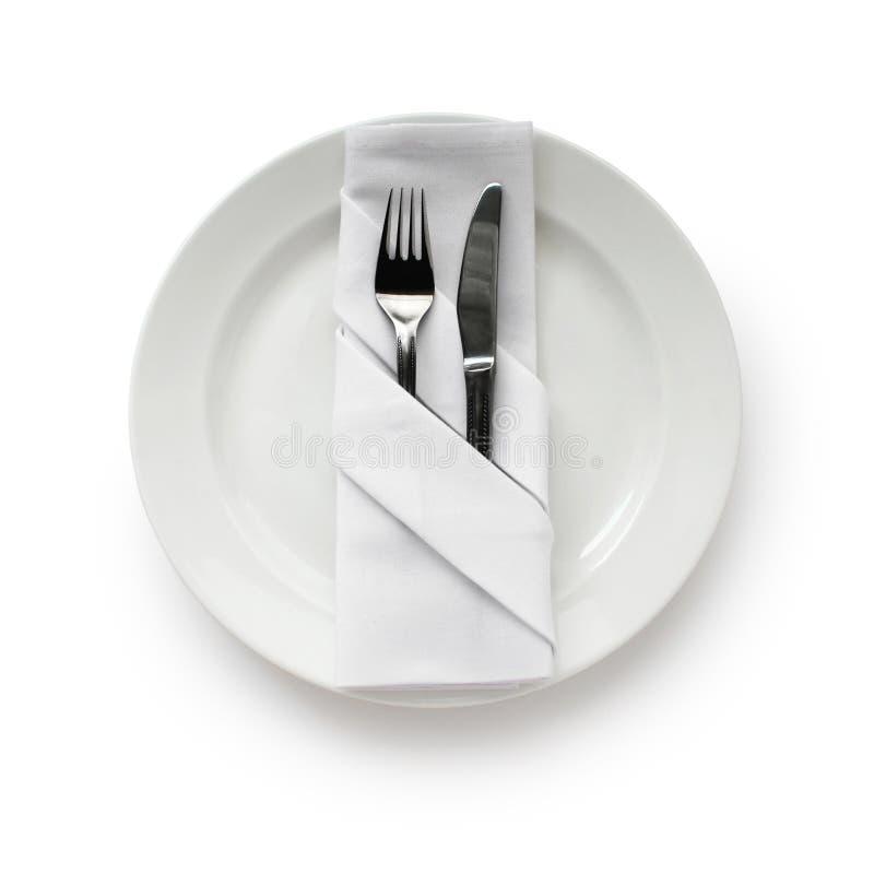 被折叠的餐巾设置表 免版税库存照片