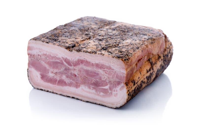 被按的烟肉用胡椒 图库摄影