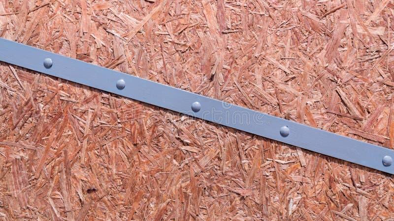 被挤压的锯木屑板的纹理与胶浆OSB的 库存照片