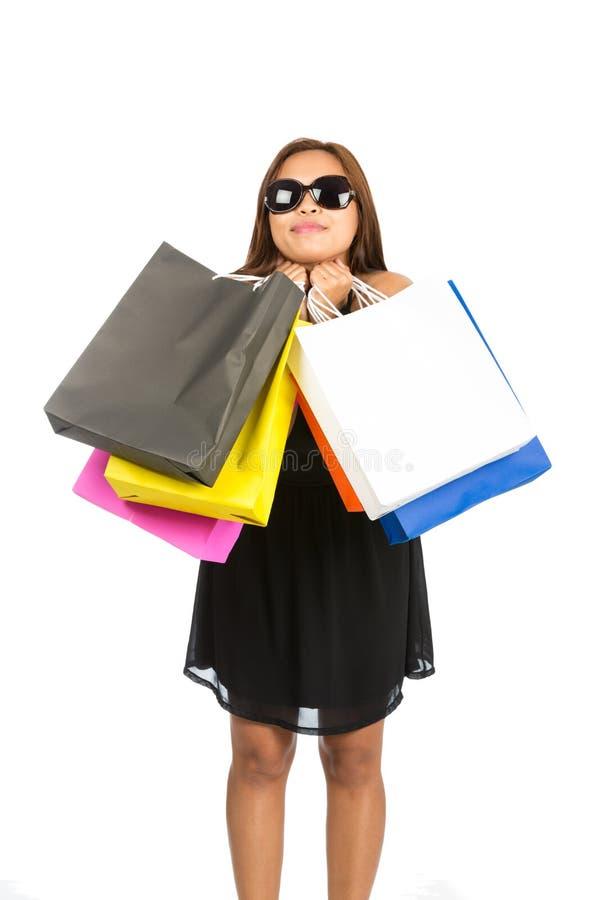 被掀动的亚洲女性拥抱的购物袋头 库存照片