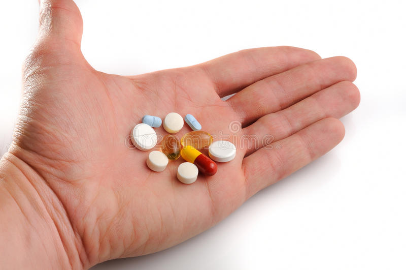 被提供的药片在手边 免版税库存照片