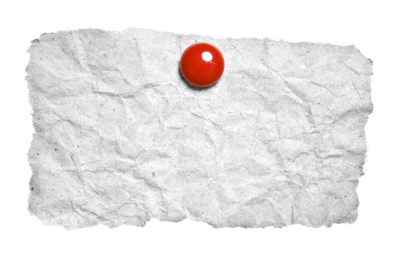 被撕毁的夹子纸红色 库存图片