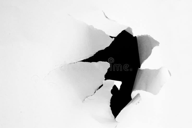 被撕毁的漏洞 免版税库存照片