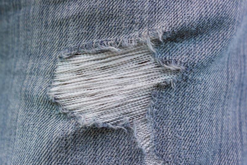 被撕毁的牛仔裤 库存照片