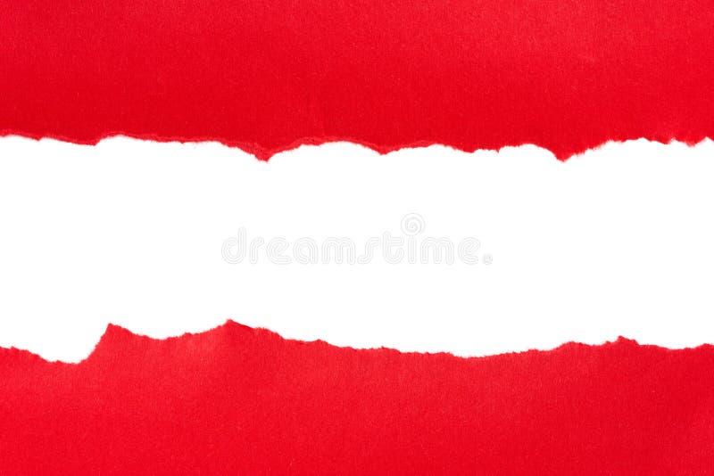 被撕毁的红色纸张 免版税图库摄影
