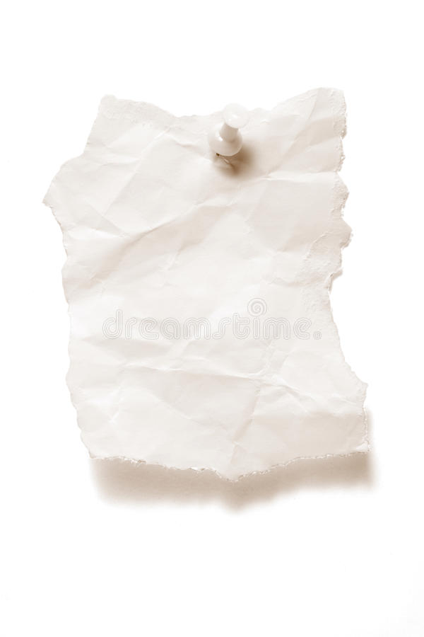 被撕毁的纸图钉 库存图片