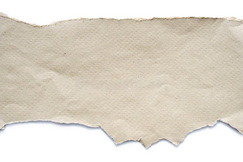 被撕毁的纸板料 库存照片