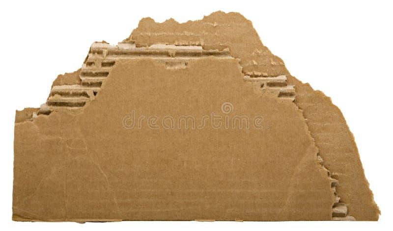 被撕毁的纸板片断 免版税库存图片