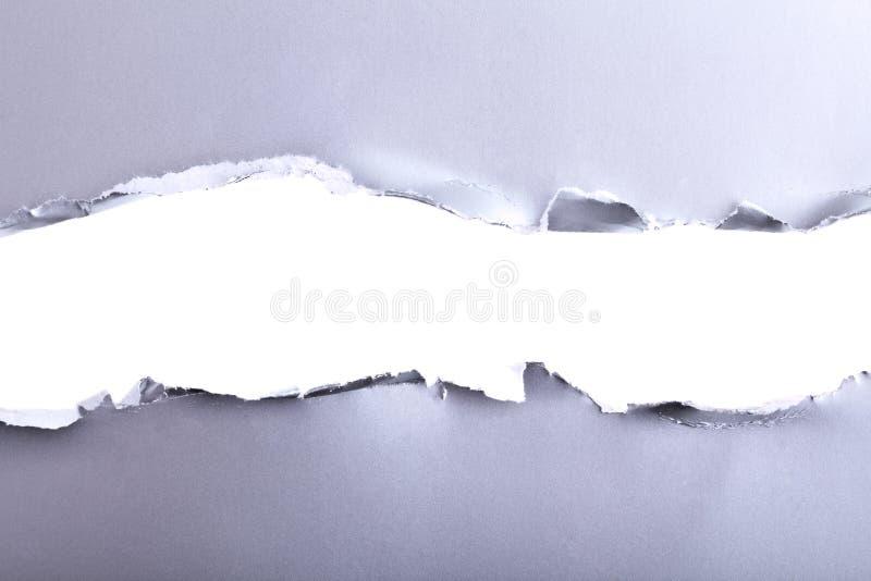被撕毁的纸背景 图库摄影