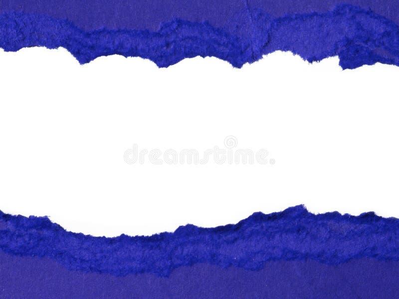 被撕毁的蓝纸 库存照片