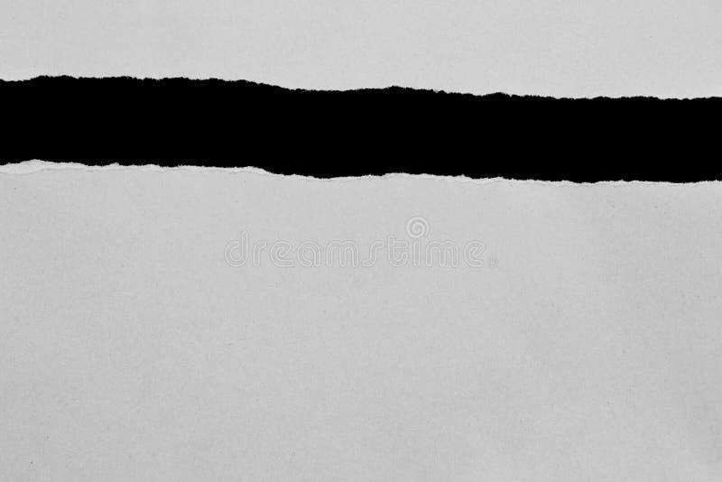 被撕毁的裂口纸 图库摄影
