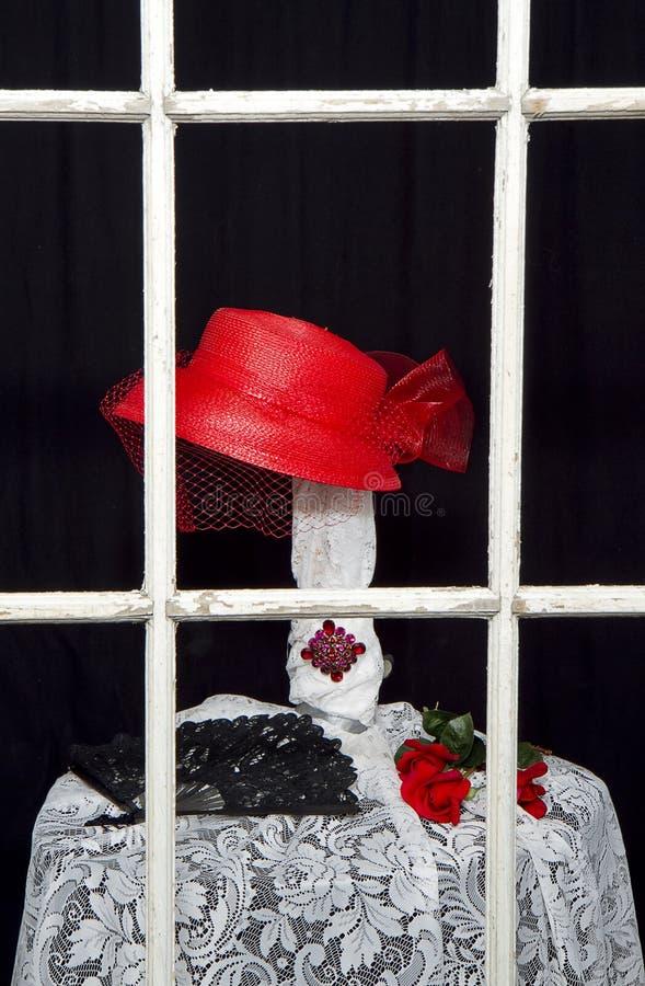 -被显示的减速火箭的红色帽子 免版税库存图片