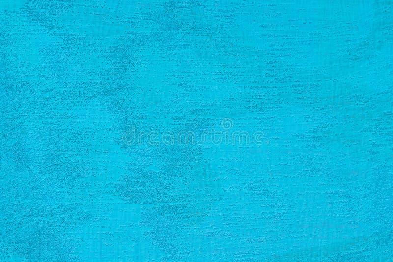 被构造化的蓝色油灰 葡萄酒或威尼斯式灰泥纹理脏的背景  库存图片