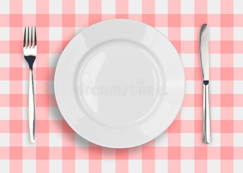 被检查的叉子刀子牌照顶视图白色 免版税库存照片