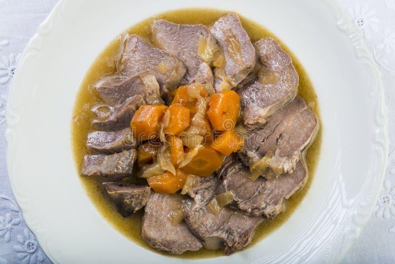 被炖的猪肉舌头西班牙人样式 免版税库存图片