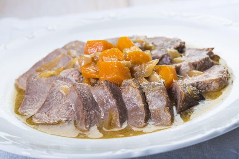 被炖的猪肉舌头西班牙人样式 免版税图库摄影