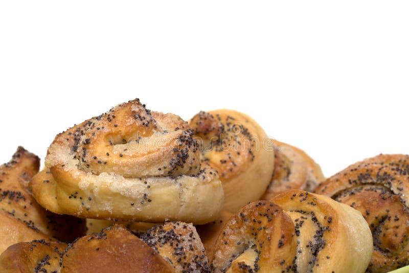 被烘烤的小圆面包新近地罂粟的种子 免版税库存图片