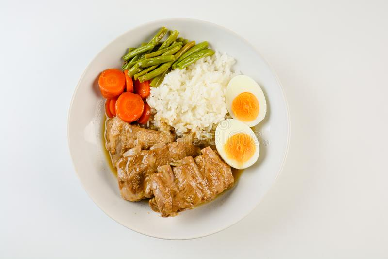 被烘烤的排骨用米 免版税图库摄影
