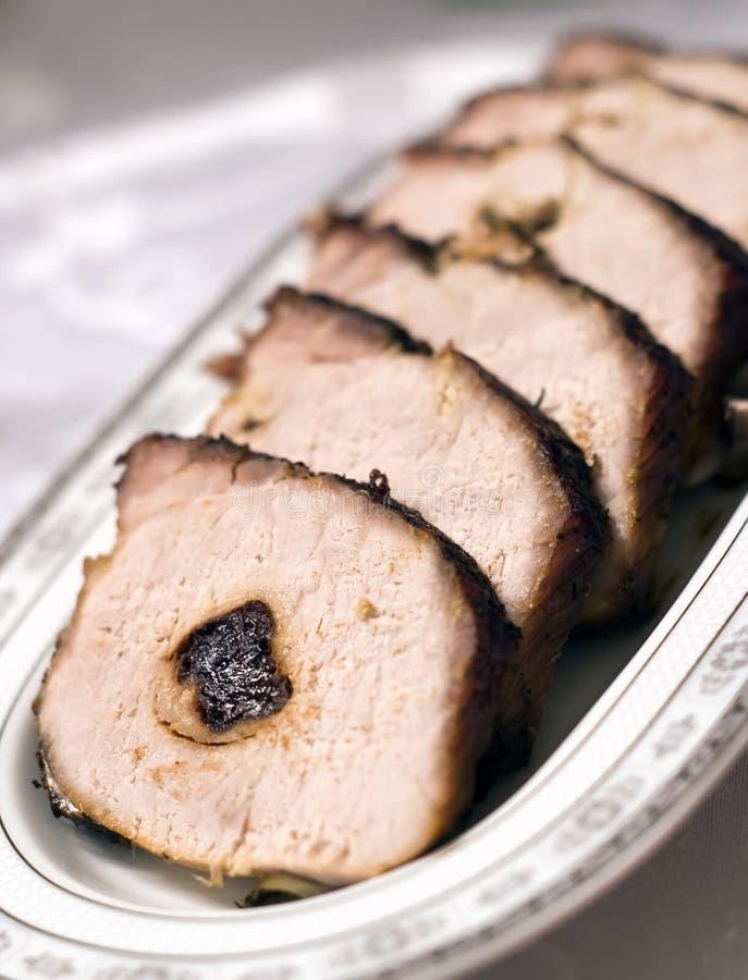 被烘烤的李子猪肉 免版税库存照片