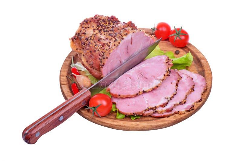 被烘烤的猪肉脖子,蕃茄,胡椒,大蒜 免版税库存图片