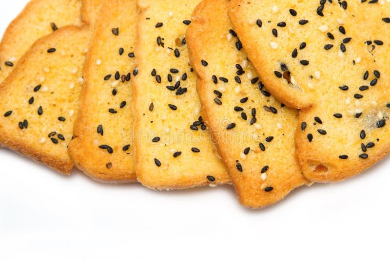 被烘烤的面包,涂奶油和芝麻 免版税图库摄影