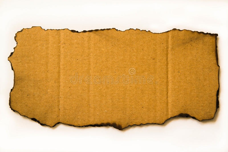 被烧焦的纸板 免版税库存图片