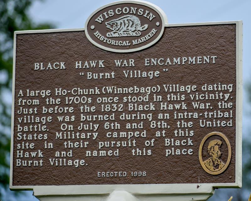 被烧的村庄布莱克霍克战争扎营历史标志 免版税库存照片