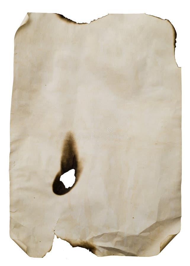 被烧的漏洞纸张页 免版税图库摄影