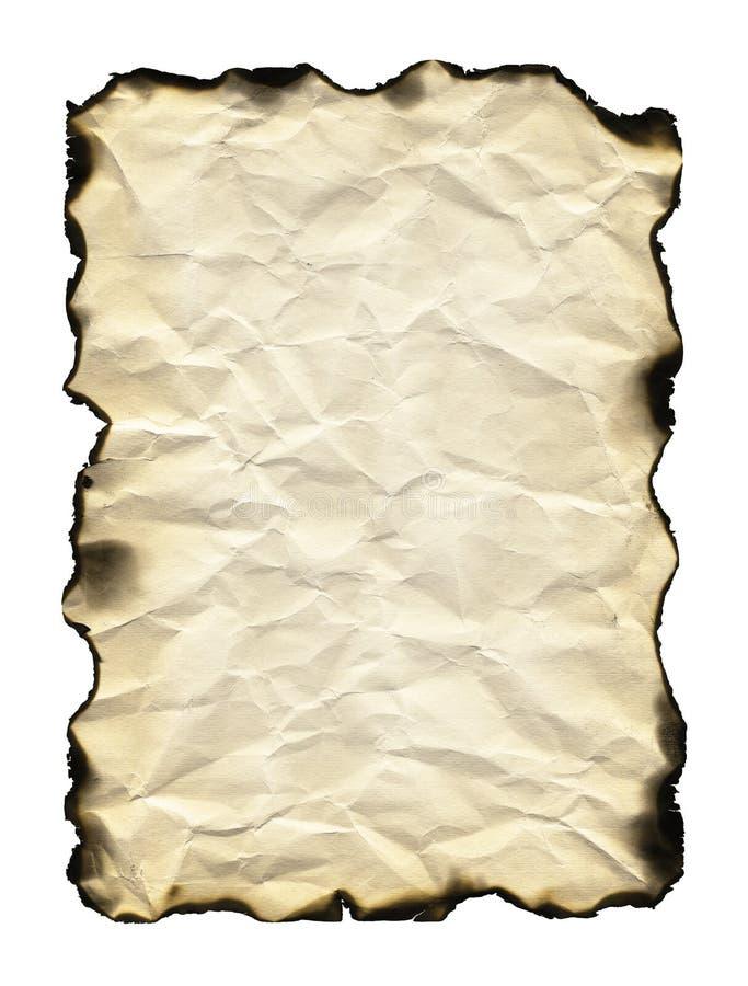 被烧的边缘老纸页 库存照片